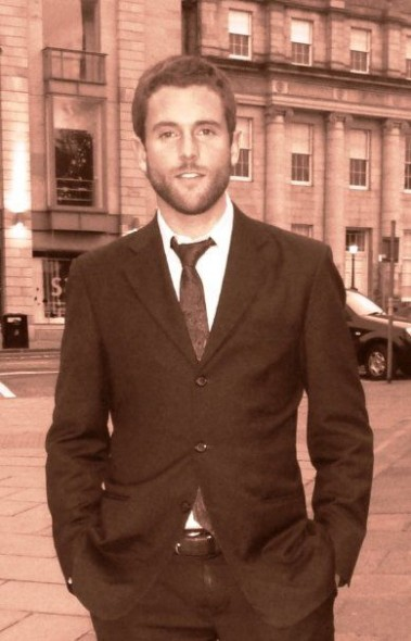 Lachlan McWilliam in business suit, New Town, Edinburgh.