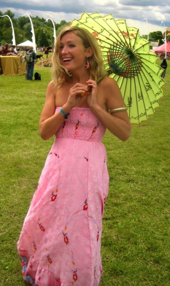 Lucie in pink dress with parasole at Secret Garden Party for Vagabond Van.