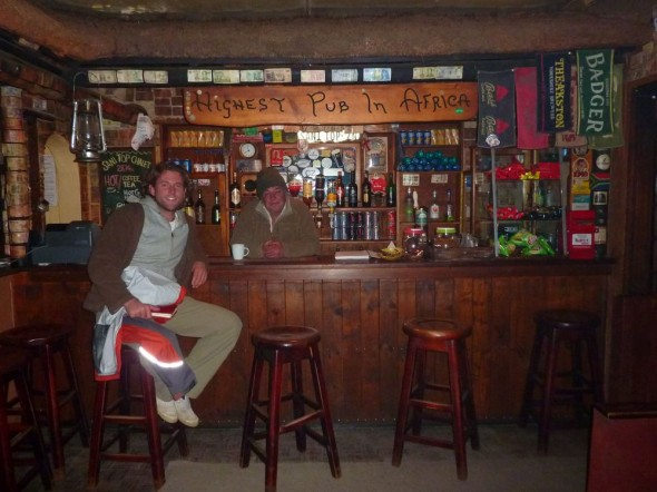 Rodger behind the bar at the highest pub in Africa, Sani Top Chalet, Lesotho.