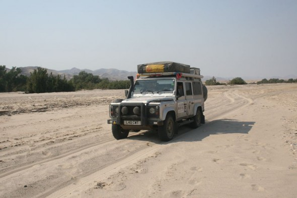 Lula the Landy cruising down a dry sandy river bed, near Purros, Kaokoland, Namibia.