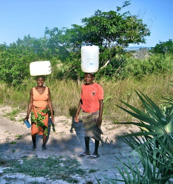 Local women making their daily commute to and from the well. Pomene, Mozambique.