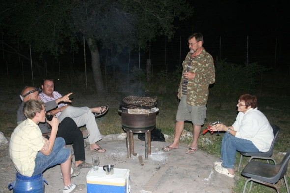 Having a braai with Eugene's family. Sitting around braai while cooking. Kalkfontein farm, Grootfontein, Namibia.