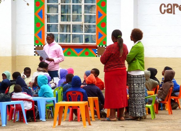 Wrapped up warm and having Sunday School lessons outside. Bulembu is home to over two hundred children who have lost their parents to AIDS. Swaziland.