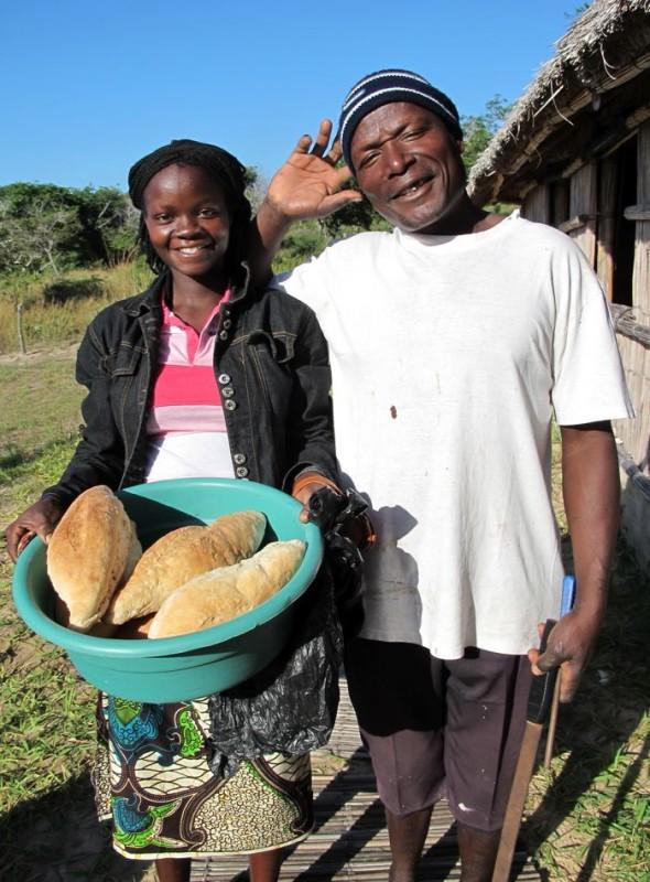 Estella and Isaiah arrive with fresh Pão (bread). (Picture taken by Captain Pat.) Pomene, Mozambique.