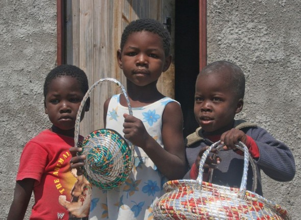 Penane's children show us the Vagabond Van Chip Bags, Maun, Botswana.