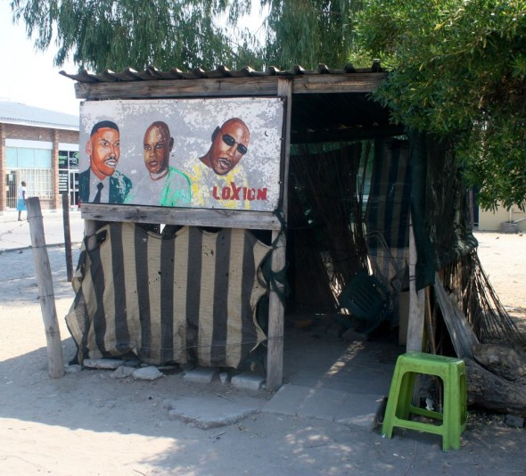 A barber shack on the side of the road with cool paintings, Maun, Botswana.