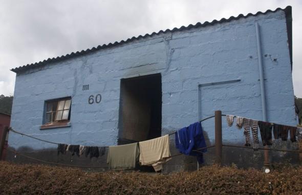 Muted washing line with stripey socks. Bulembu, Swaziland.