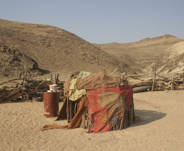 Himba huts at Purros Himba tribe village, Namibia.