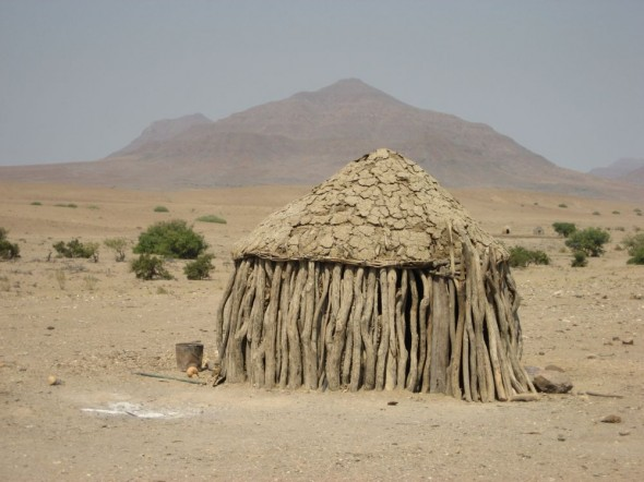 A Himba hut made from trees near Purros, Kaokoland, Namibia.