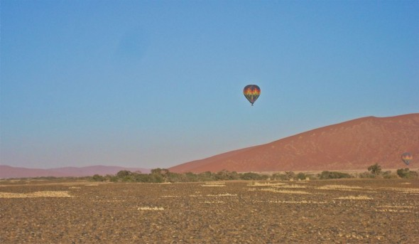 A hot air balloon over Sossusvlei sand dunes, Namibia.