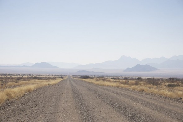 Heading towards blue mountains at Sossusvlei sand dunes, Namibia.