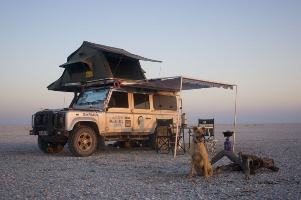 Bow Wow sitting by Lula the Landy at The Makgadikgadi Pan, Botswana.