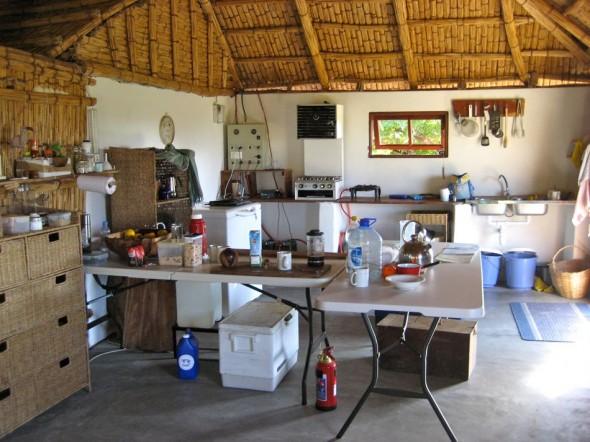 Tea towels hang on twigs in Pat's organic kitchen. Pomene, Mozambique.