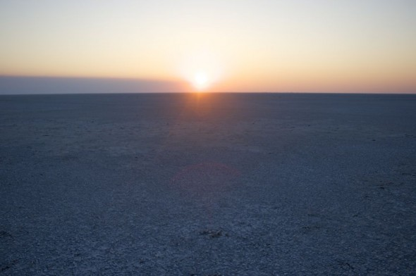 The sun setting over the salt pans at The Makgadikgadi Pan, Botswana.