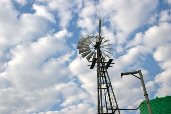 Windmill with cloudy blue sky. Kimberley, South Africa.