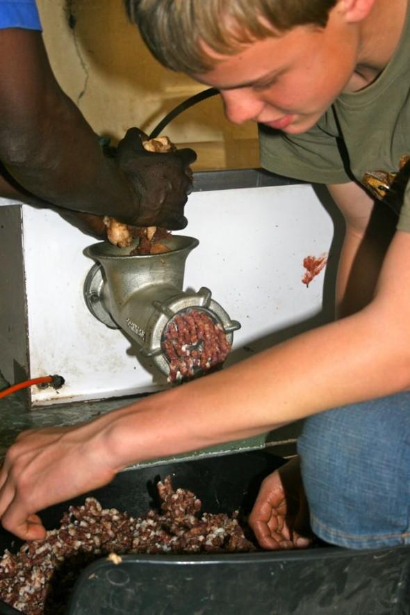Making boerewors using hand machine. Grootfontein, Namibia.
