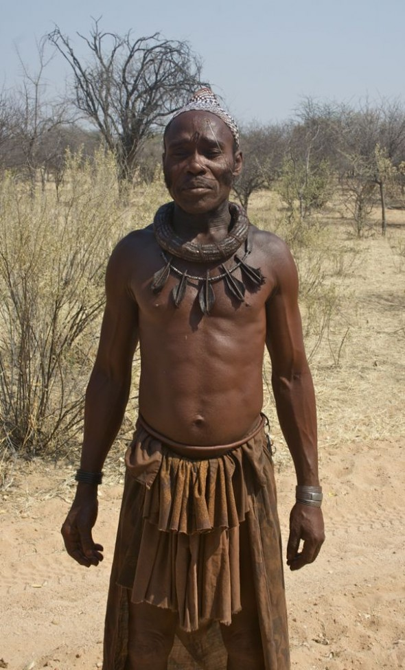 A Himba male standing tall with his tied skirt and jewellery, Kaokoland, Namibia.