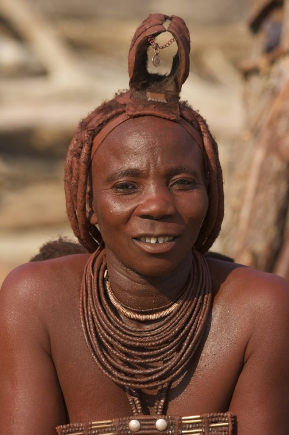 Himba woman at Purros Himba tribe village, Namibia.