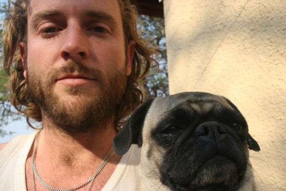 Lachlan and small pug dog named Pepsi. Grootfontein, Namibia.