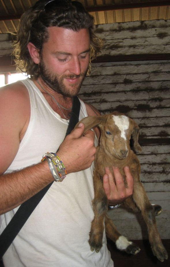 Lachlan holding a baby goat (kid). Grootfontein, Namibia.