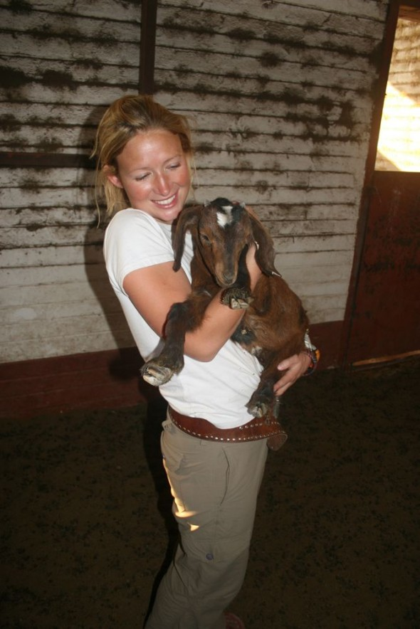 Lucie holding a baby goat (kid). Grootfontein, Namibia.
