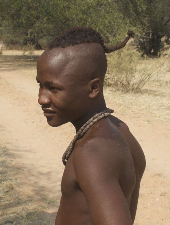 A single Himba male with hair in a mohawk-ish braid, Kaokoland, Namibia.