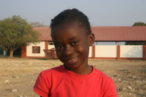 Young girl smiling on farm at Grootfontein, Namibia.