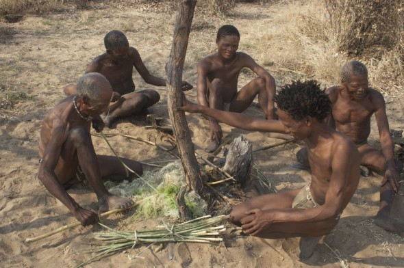 Group of bushmen making bows and arrows. Ju/'hanse San people, or as they are more commonly known, the Bushmen, near Tsumkwe, eastern Namibia.