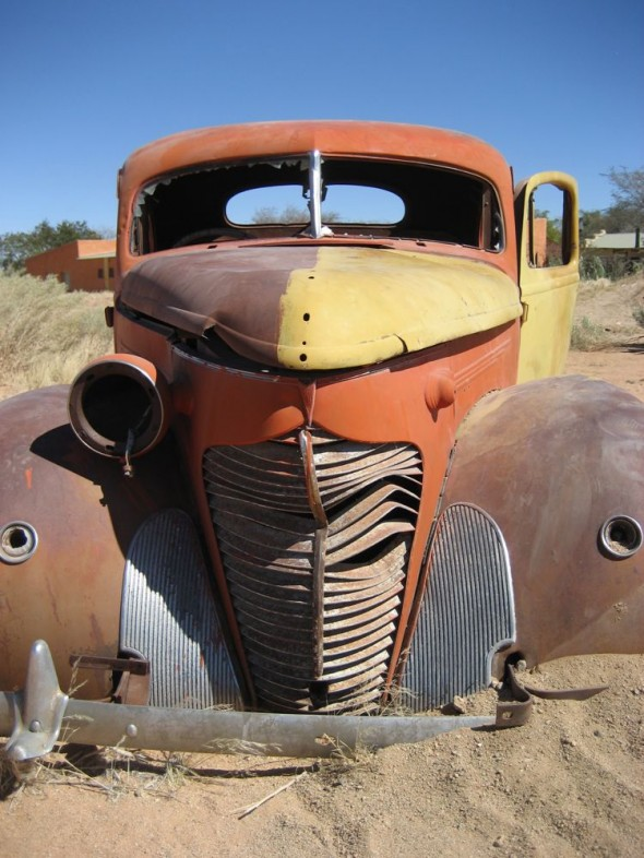 Old antique rusted car in deep sand, Namibia.
