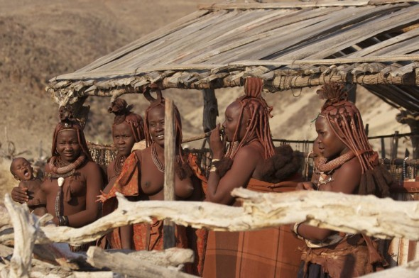 Himba women at Purros Himba tribe village, Namibia.
