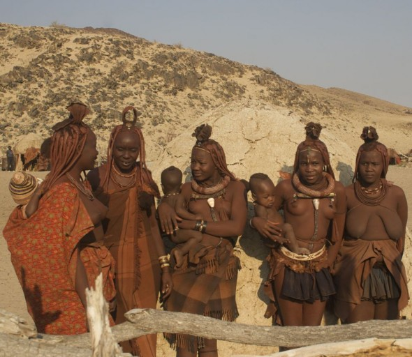 Himba women and babies, Purros Himba tribe village, Namibia.