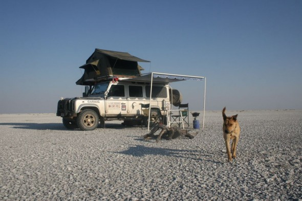 The Vagabond Adventure's camp setup with Bow Wow. The Makgadikgadi Pan, Botswana.