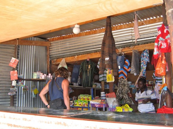 Lachlan looking for some food in the local store, Epupa Falls, Namibia.