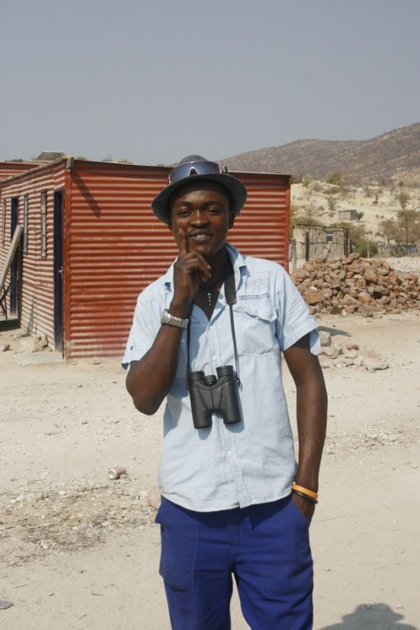 A fashionable local with hat and binoculars at Epupa Falls, Namibia.
