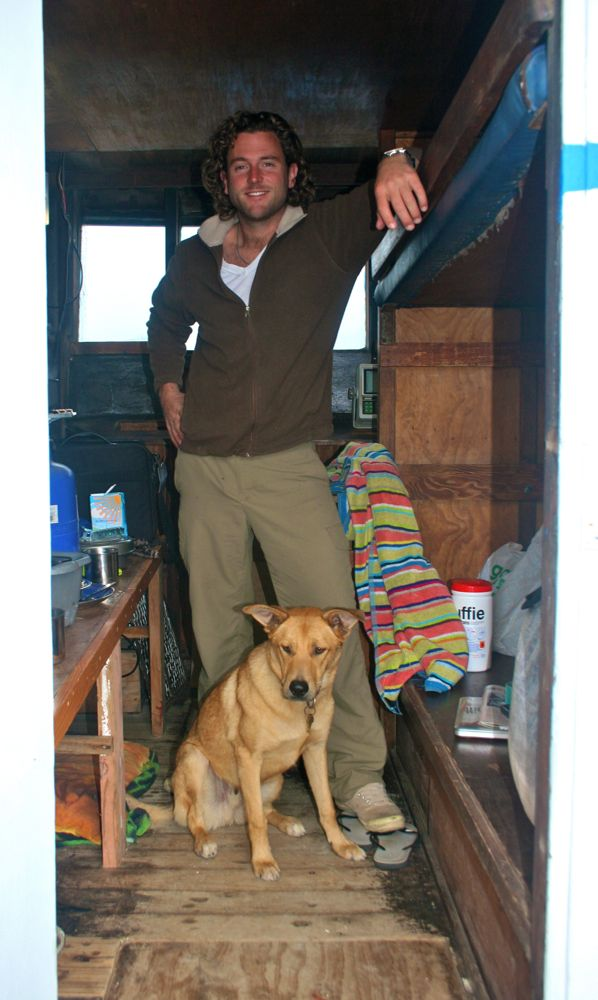 Lachlan and Bow Wow inside the old boat style accomodation at Dias Point, Lüderitz, Namibia.
