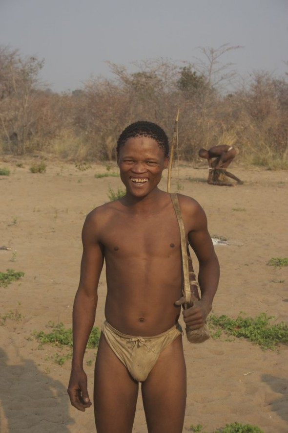 Bushman standing with his bow after the hunt. Ju/'hanse San people, or as they are more commonly known, the Bushmen, near Tsumkwe, eastern Namibia.