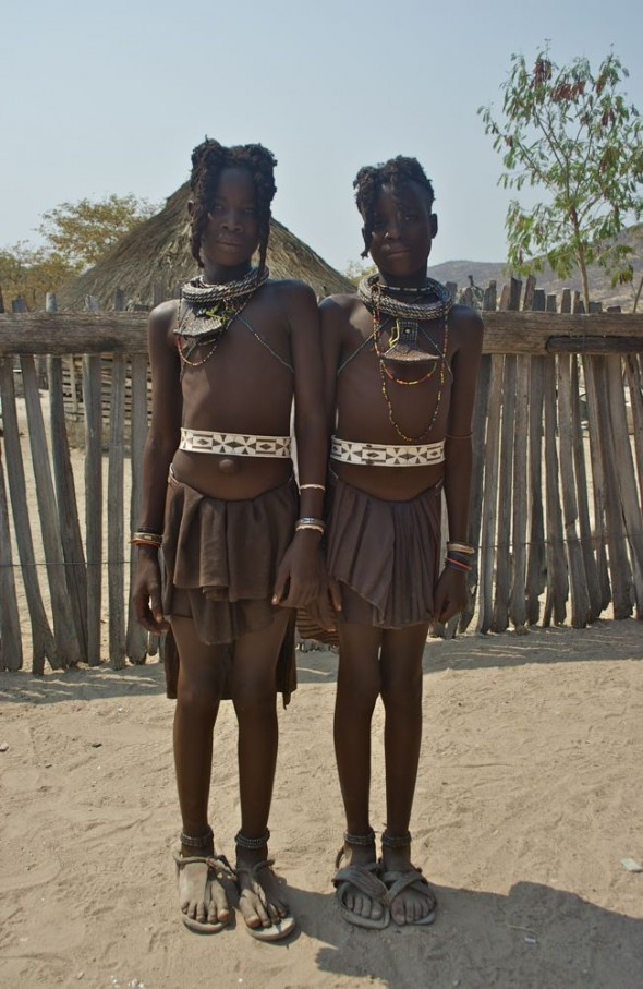 Two young himba girls with amazing hair and jewellery, Epupa Falls, Namibia.