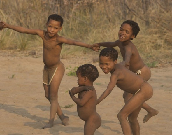Children dancing. Ju/'hanse San people, or as they are more commonly known, the Bushmen, near Tsumkwe, eastern Namibia.