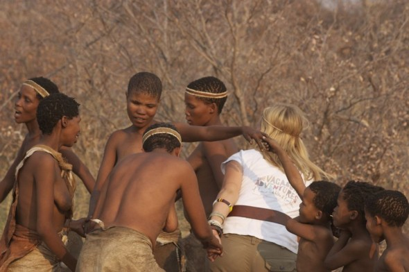 Lucie dancing with women. Ju/'hanse San people, or as they are more commonly known, the Bushmen, near Tsumkwe, eastern Namibia.