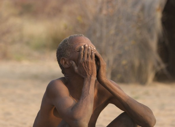 The doctor after performing a special trance dance for sick patient. Ju/'hanse San people, or as they are more commonly known, the Bushmen, near Tsumkwe, eastern Namibia.