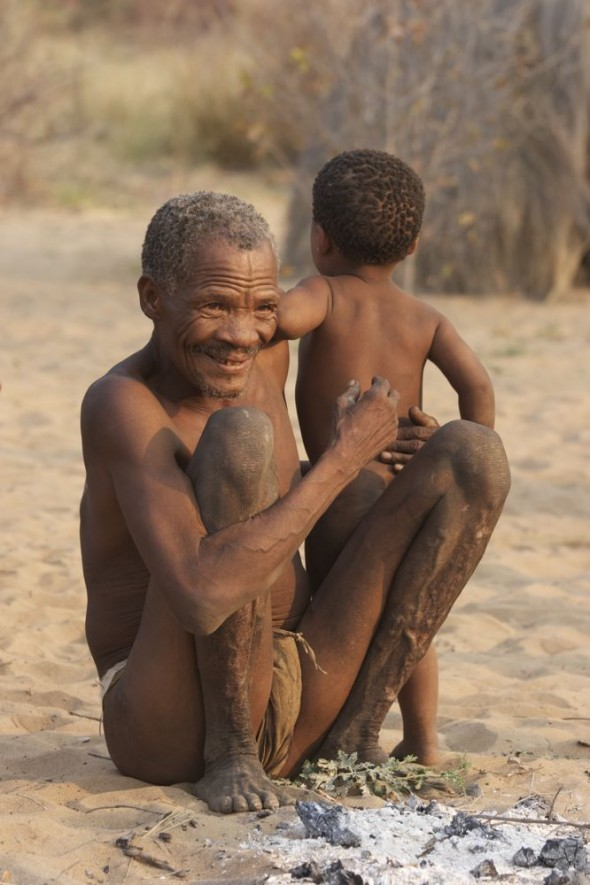 Doctor with child. Ju/'hanse San people, or as they are more commonly known, the Bushmen, near Tsumkwe, eastern Namibia.