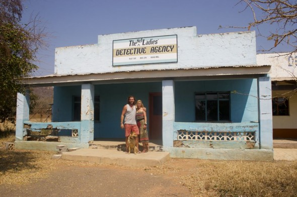 Lucie, Lachlan & Bow Wow from The Vagabond Adventures standing out the front of the offical No. 1 Ladies' Detective Agency, Gaborne, Botswana.