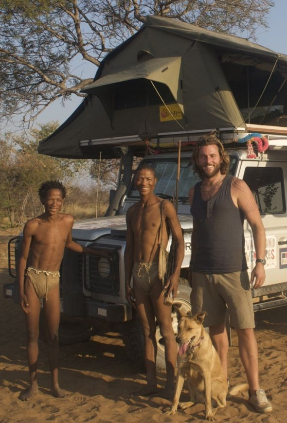 Lachlan, Bow Wow and two Bushmen. Ju/'hanse San people, or as they are more commonly known, the Bushmen, near Tsumkwe, eastern Namibia.