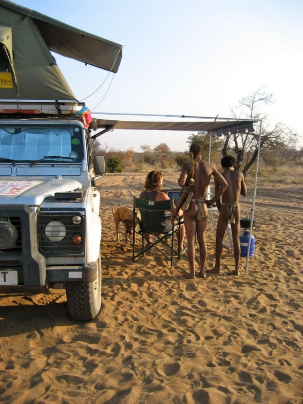 Lachlan showing our website to two bushmen. Ju/'hanse San people, or as they are more commonly known, the Bushmen, near Tsumkwe, eastern Namibia.