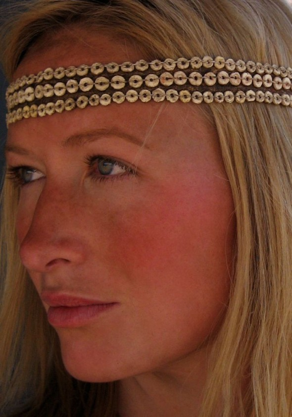 Lucie wearing ostrich shell and blue duiker headband. Ju/'hanse San people, or as they are more commonly known, the Bushmen, near Tsumkwe, eastern Namibia.