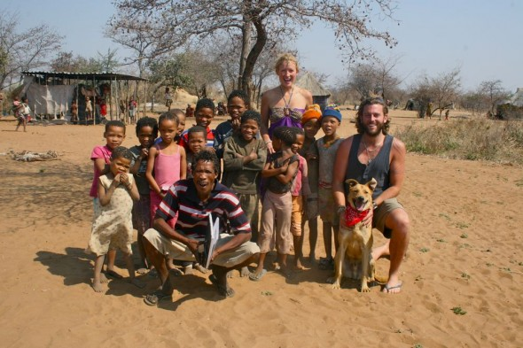 Lucie, Lachlan & Bow Wow from The Vagabond Adventures with a group of Bushmen children in normal clothes. Ju/'hanse San people, or as they are more commonly known, the Bushmen, near Tsumkwe, eastern Namibia.