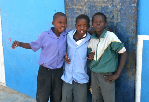 Herero kids outside a shop, Sesfontein, Namibia.