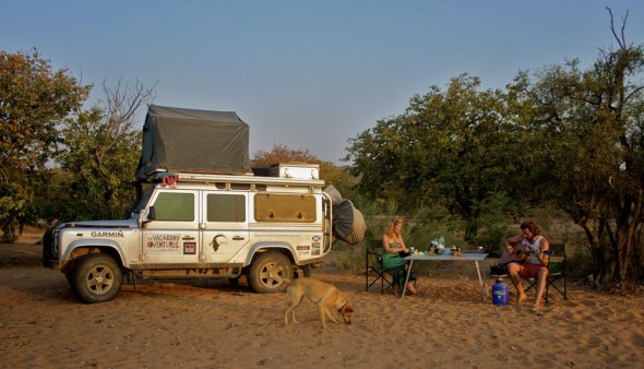 The Vagabond Adventures with their camp setup just past a Himba settlement called Orupembe on the bed of a dry nameless stream. Kaokoland, Namibia.