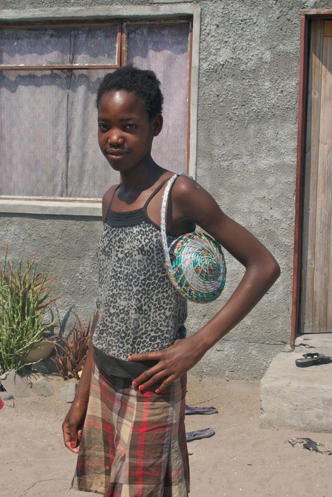 Onalenna modelling Vagabond Van Chip Bag in Maun, Botswana.