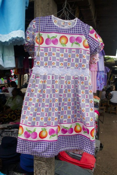 Colourful Chinese dress at Harare market with fruit pattern, Zimbabwe.